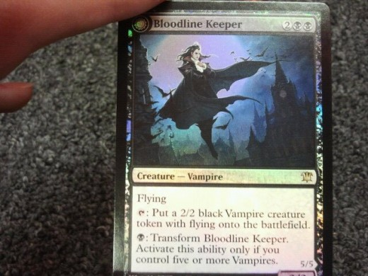 I know that Bloodline Keeper/Lord of Lineage is an Innistrad card, but at the Dark Ascension pre-release I pulled this in the first pack I opened- needless to say I ran vampires. I did pretty well, 2 - 1 - 2 (2wins, 1draw, 2losses)