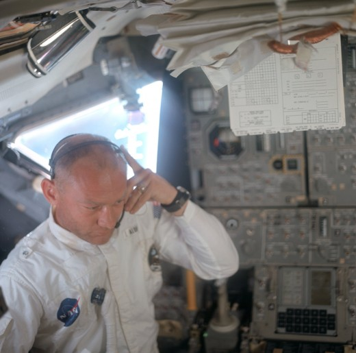 Astronaut Edwin E. Aldrin during checkout and inspection of the Apollo 11 Lunar Module. The AGC can be seen at lower right.