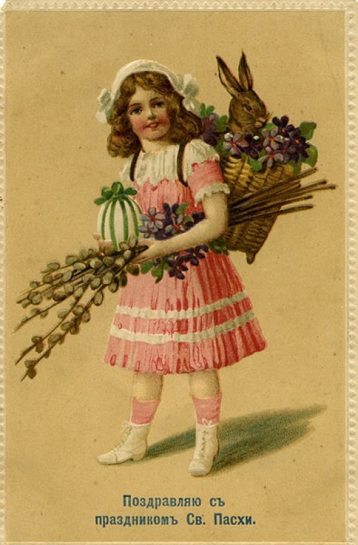 Old Russian Easter Postcard.  Girl carrying basket with Easter Bunny int he back.