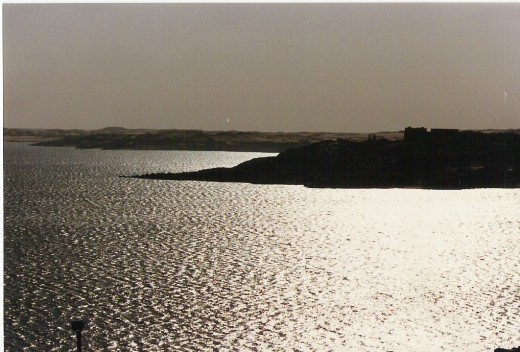 Silhouette of Philae (right) against Lake Nasser.