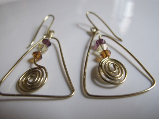 Spirals can be worked into a funky design like these triangles.