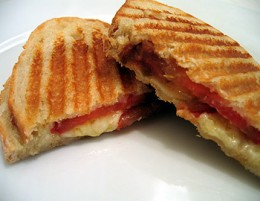 Grilling your sandwiches with a Foreman Grill eliminates the need for butter.  Vegetables are a delicious additive to grilled cheese.