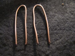 Create two even ear wires by centering and bending the wire lengths.