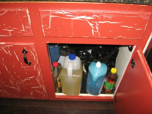 Childproofing your kitchen cabinets will keep kids safe from a host of harmful substances. I baby proof my entire kitchen via a closed door.