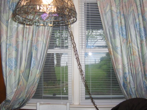 This swag glass lamp traveled through many houses I put on the market, places I lived.. I had it for 30 years.  Note this great view out the window
