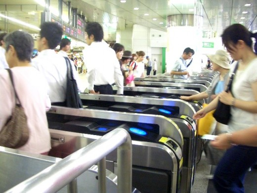 Passengers passing through a ticket gate.