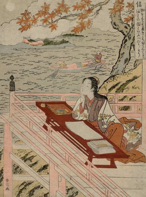 A picture of Murasaki Shikibu, a famous Japanese female writer, sitting at her writing desk.