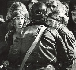 POLICE CONFRONT PROTESTERS who are voicing their anti-Vietnam War opinions as guaranteed in the Bill of Rights of The Constitution of The United States of America.