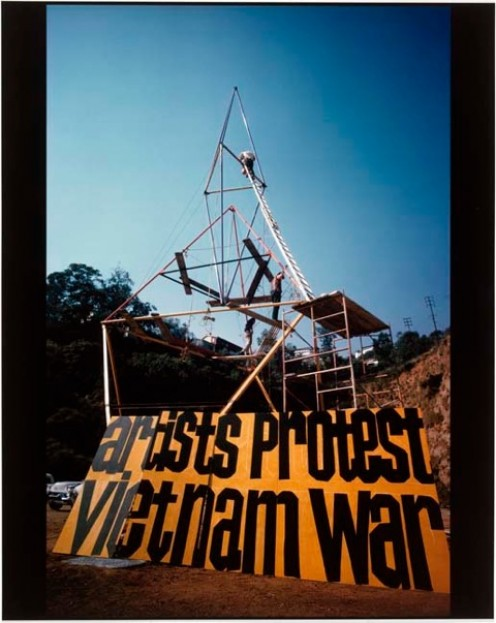 HUGE ANTI-WAR SIGNS were erected at the Woodstock Music and Art Fair to voice artists' protests against the Vietnam War.