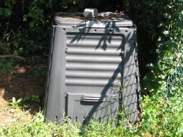 Plastic compost bin with accessible door in front