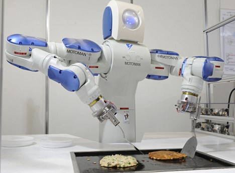 Motoman SDA10, an industrial robot that relies on speech recognition technology making the Japanese pancake, okonomiyaki.
