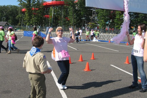 My grandmother crossing the finish line triumphantly at the Susan G. Komen Race for the Cure in Oct. 2009. You'd never believe it by how healthy she looks in this picture, but we lost her five months later.