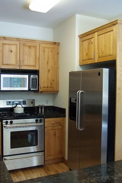 Try out your kitchen! It's that big room with the food storage facility and that machine that heats up!