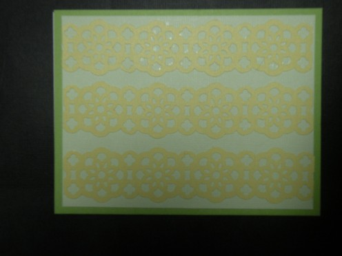 Lacy punch cutouts adhered