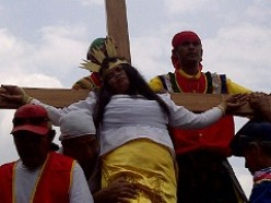 Why do some people want to be nailed on a cross during holy week/Lent?