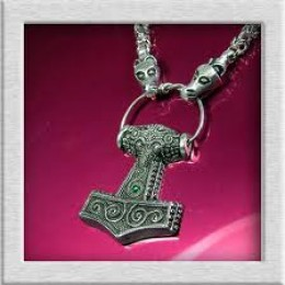Manx version of Mjollnir with Jormungand - World Serpent - chain links. Mjollnir was Thor's Hammer