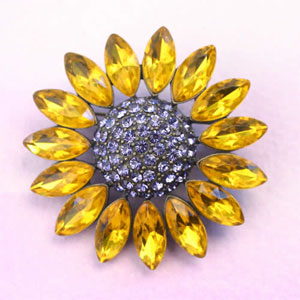 Brooches are great in the fall.  A bright brooch like this one can be worn on a scarf or purse.