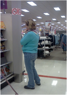 Here is a woman who took 5 minutes to decide which book to grab.