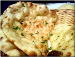 Naan, is quite like pizza. You can top Naan with fresh herbs and seasonings.