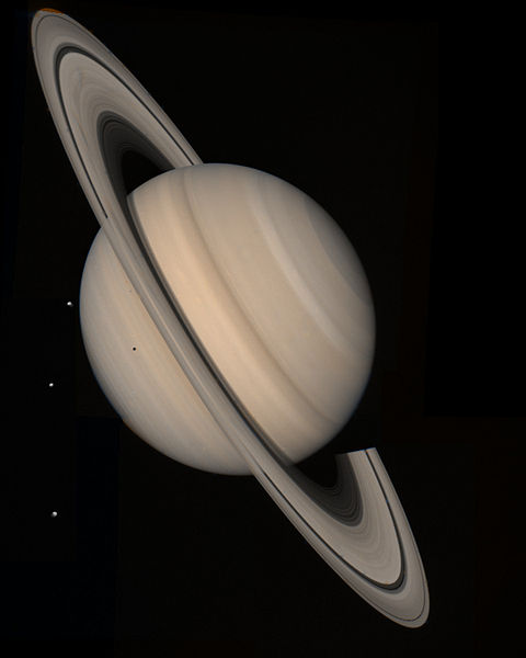 Photo of Saturn snapped by Voyager 2 space probe. I was seeing Saturn at about the same angle tonight, but very, VERY tiny (and less detail; I couldn't see stripes, only the rings.)