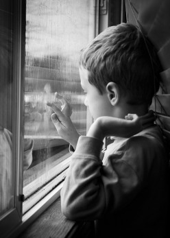 Why does a window pane become damp if one breathes on it?