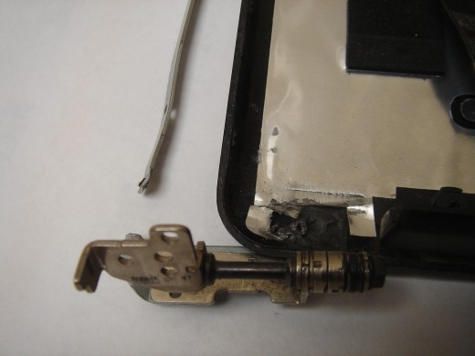 Broken hinge and broken screw holders on the cover.