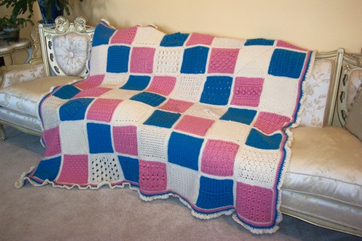 This Afghan is made in all squares and each square is a differnt pattern and stitch.