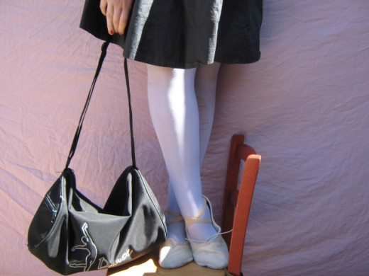 Typical ballet garb includes tights, ballet slippers, and a leotard. Tutus, traditional symbols of ballet, are just for show & are impractical for dance class.