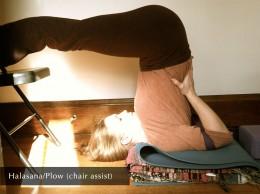 Halasana/Plow (chair assist)