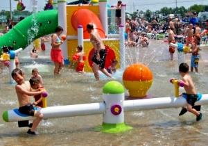 Kids in the water spray area - White water mountain water park