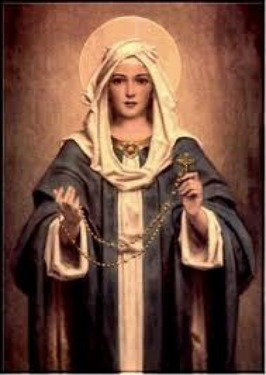 The Virgin Mary, very much like the lady that opened the door and let me inside, when I was in danger in my dream.