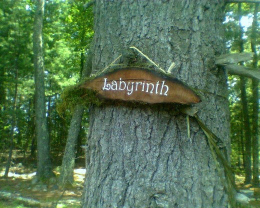 Sign that welcomes walkers to our wooded labyrinth.