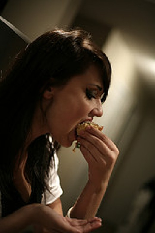 """""""wolfing-down"""" food like a starved bear. And looking hot in the process. You can't beat the combo of bad impressions and a pretty girl."""