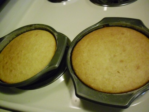 These two cakes are cooked perfectly according to the fingertip test for doneness, and are all ready to be frosted.