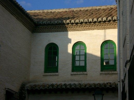 Three green windows in Granada, Spain