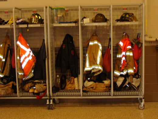 The firemen hang their fire gear in individual lockers.