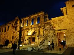 During a warm summer night, the lights reflecting off the arched stone walls give a luminescence of nostalgia and antiquity.