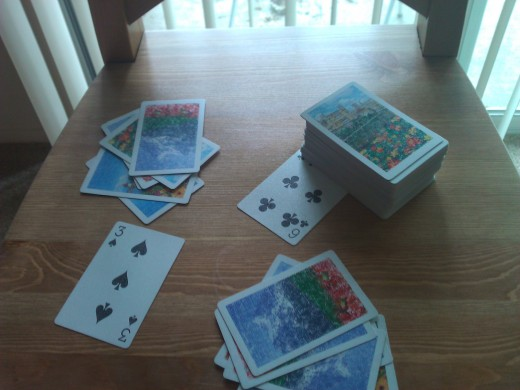 Deal 13 cards each, pull out one joker for the game and keep it under the stack, lay the top card of the pile face up as the starting or running card.