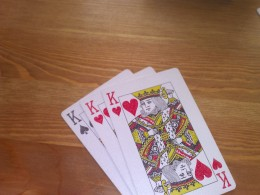 An incorrect Trail - you cannot have two cards of the same suit - like 2 King of Hearts in this case