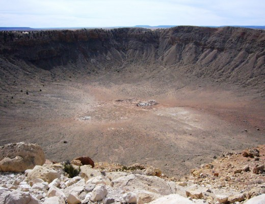 Barringer Crater, near Flagstaff, Arizona. This 3/4-mile-wide (1.1km) crater was created by the impact of an iron-nickel meteorite about 150 feet across (45 meters).