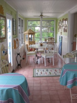 The enclosed front porch is bright and functions as a breakfast room and game room.