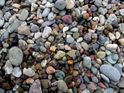 Why are pebbles on the beach more or less rounded?