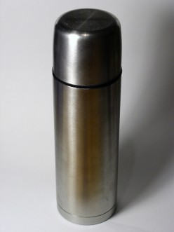 Why do liquids keep hot so long in a vacuum flask?
