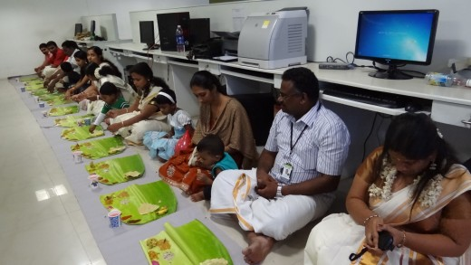 Having Onasadhya ( lunch in traditional way in banana leaf) inside the office
