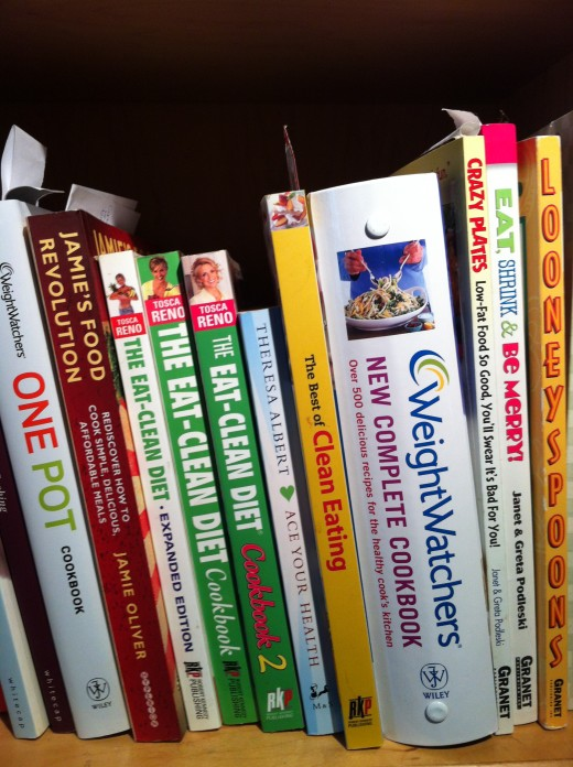 Healthy cooking books on my bookshelf in the kitchen