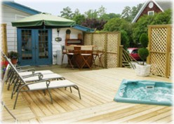 Shared deck and hot tub.