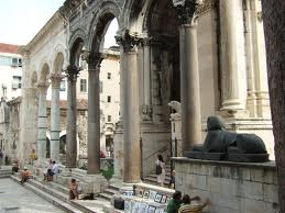 The fantastic classical columns and stonework of the Ancient Peristil with sphynx in the foreground.