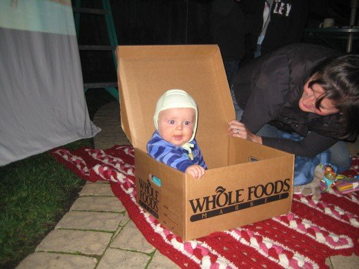 The meal order box from Whole Foods,  customized to your preferences, doubling as a seat for our 7-month-old son.