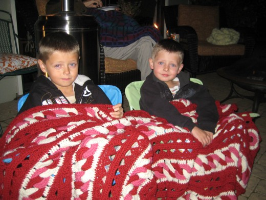 All cozy and tucked in, our two older boys think there is nothing better than an outdoor movie.