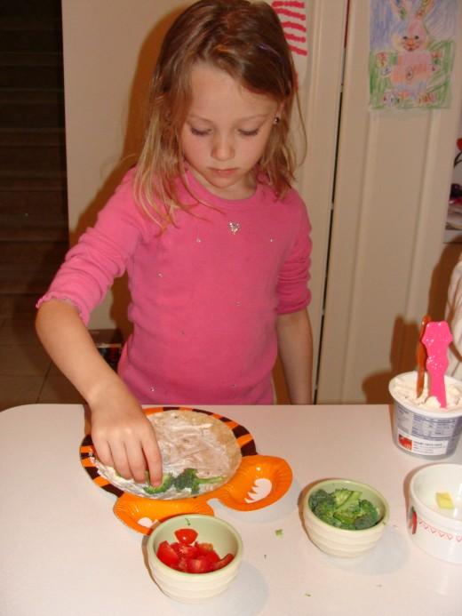 Adding the yummy veggies!